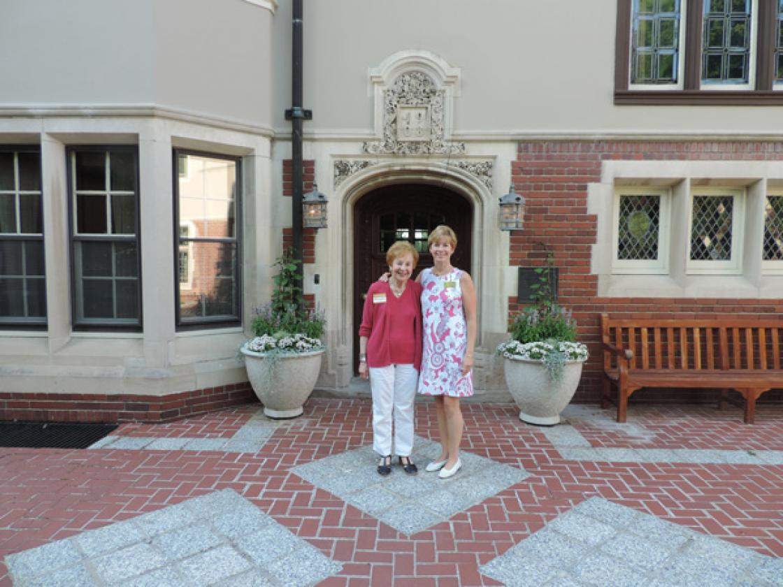 Photograph of two Cranbrook House & Gardens Auxiliary volunteer docents in front of Cranbrook House.