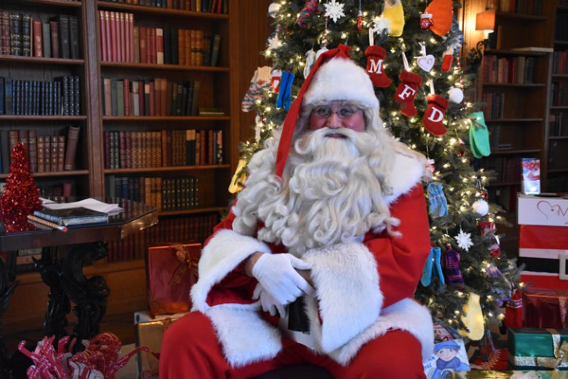 Photograph of Santa Claus in the Cranbrook House Library, December 2019.