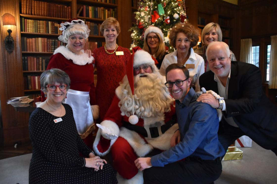 Photograph of volunteers with Santa in the Cranbrook House Library.
