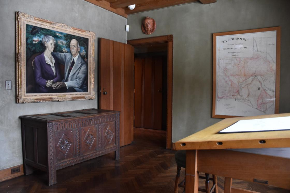 Photograph of the Cranbrook House Drafting Room and a painting of the Booths by Zoltan Zepeshy.