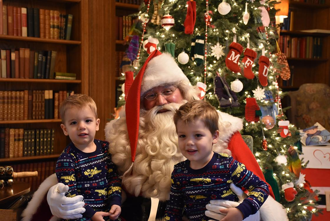 Photograph of two boys with Santa during Holiday Splendor at Cranbrook House, December 2018.