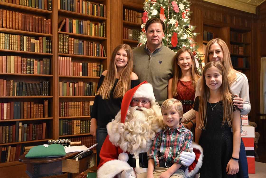 Photograph of a family with Santa during Holiday Splendor at Cranbrook House, December 2018.