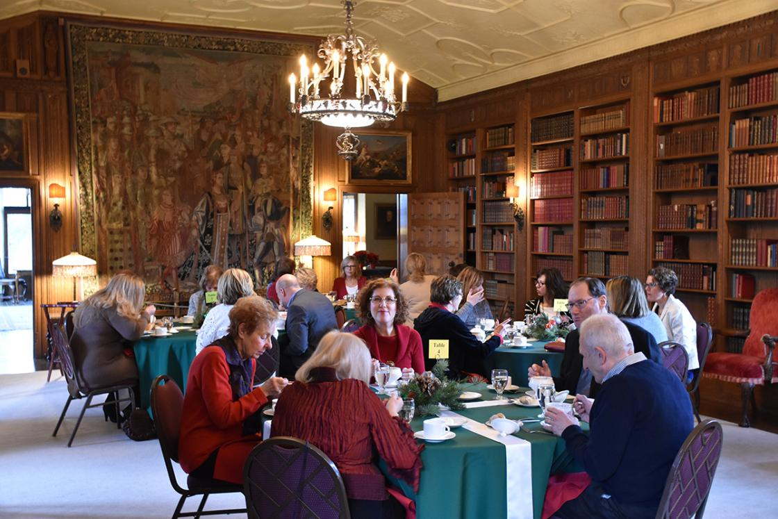 Photograph of guests in the Cranbrook House Library during a tour and holiday luncheon, December 2018.