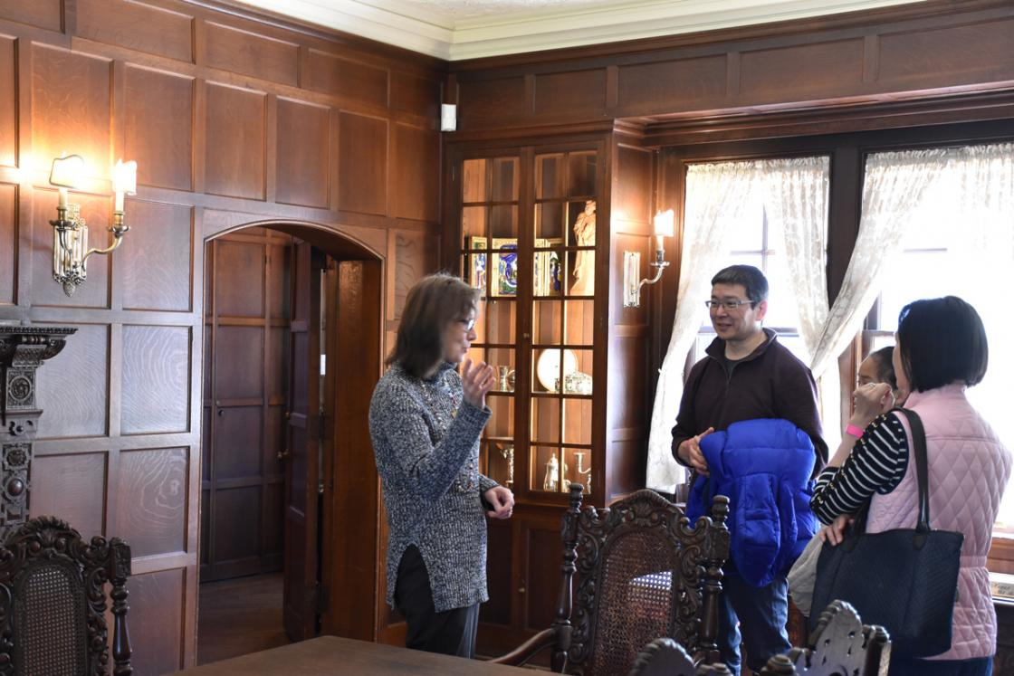 A docent with a group of guests in the Cranbrook House Dining Room, April 2019.