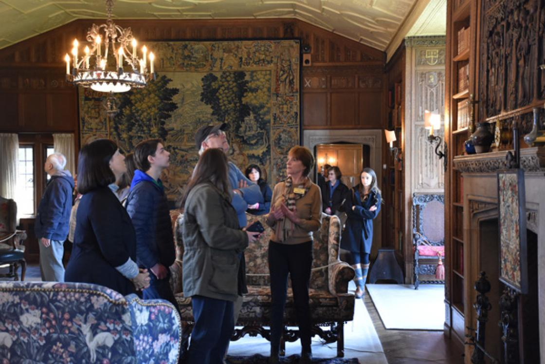 Photograph of a Cranbrook House docent giving a tour of the Library.