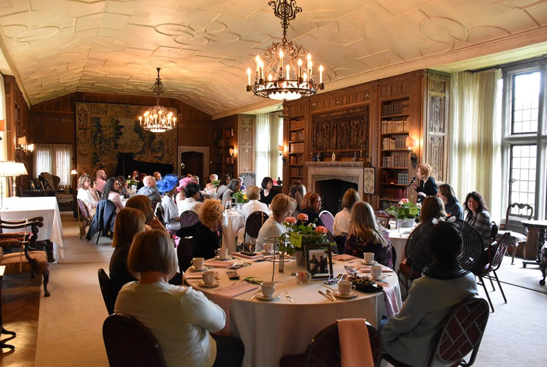 Photograph of guests in the Cranbrook House Library during a Mother's Day Tour & Tea, May 2019.