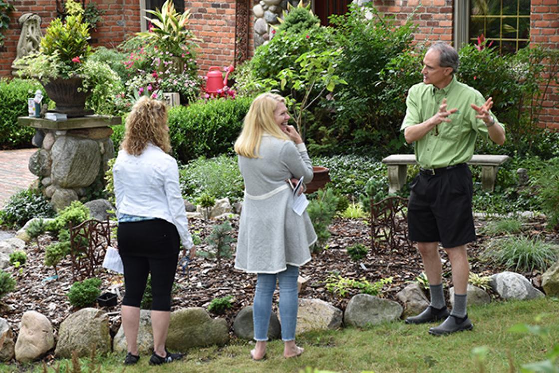 Photograph of three visitors at the Cranbrook & Friends Garden Walk.