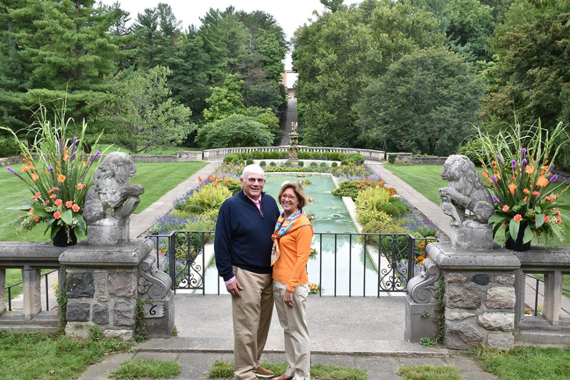 Photograph of a couple standing above the Reflecting Pool at Cranbrook House & Gardens during Art in the Elements, September 2018.