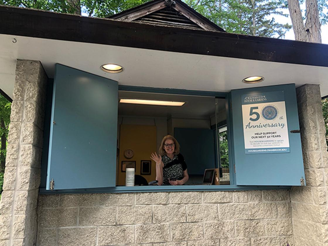 Photograph of a volunteer in the Gatehouse Welcome Center.